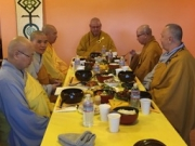 Monks and nuns at meal